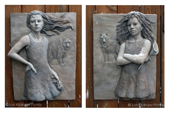 Bas relief sculptures of girls in snow by Lori Kiplinger Pandy