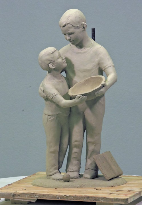 Clay sketch of two boys holding bowl ©Lori Kiplinger Pandy