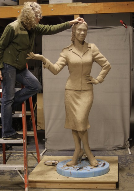 Applying clay to life size Fannie Mae Duncan Sculpture ©Lori Kiplinger Pandy