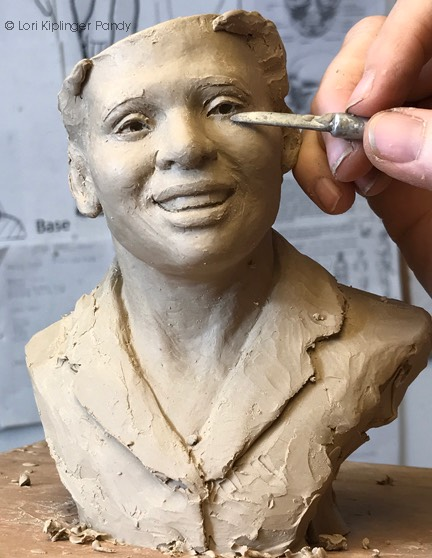 Refining features in clay ©Lori Kiplinger Pandy