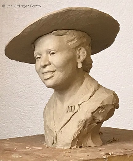 Refining features in clay - placement idea for hat ©Lori Kiplinger Pandy