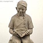 Sculpting kids with Down Syndrome - DS Girl Reading Books